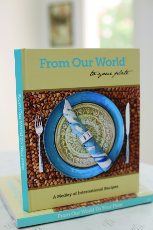The Cookbook That is Getting Everyone in the Kitchen- From Our World to Your Plate + A Giveaway!!